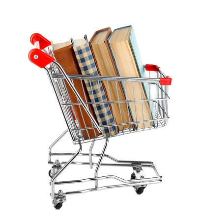Shopping cart with books isolated on white Imagens