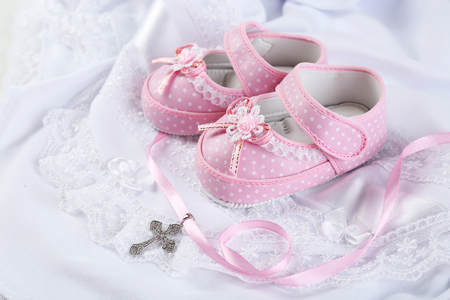 Baby shoe and cross for Christening 写真素材