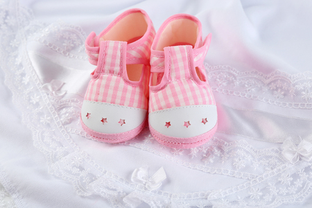 Booties on cloth background 写真素材