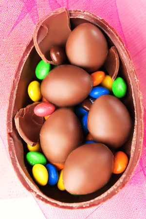 Chocolate Easter eggs on color tulle, closeup
