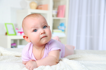 Cute baby girl, on home interior background Stock Photo