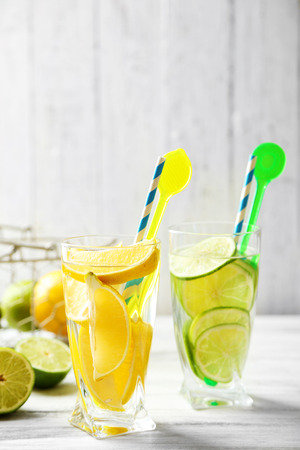 Cocktails with fresh citrus fruits on wooden background Archivio Fotografico