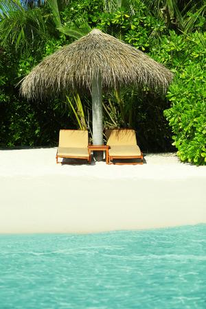 Sunbeds on beautiful beach in resort Reklamní fotografie