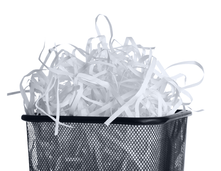 Strips of destroyed paper from shredder in trash can isolated on white Reklamní fotografie