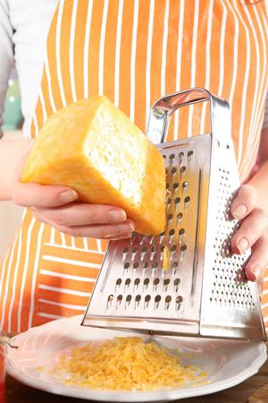 Closeup of female hands grating cheese Reklamní fotografie
