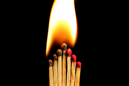 Burning matches on dark background