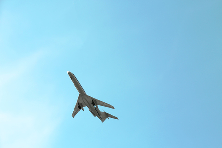 Model of plane over blue sky background