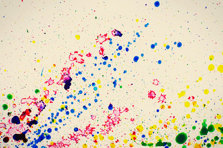 Colorful splashes of paint as background Stock Photo