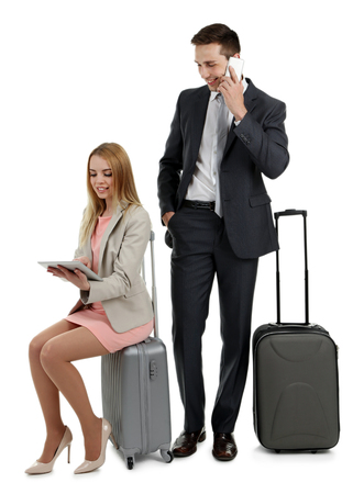 Portrait of young happy couple with baggage isolated on white Stock Photo