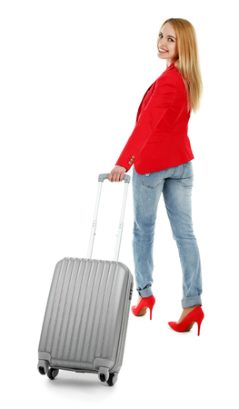 Woman holding suitcase, isolated on white Zdjęcie Seryjne