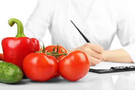 Nutritionist doctor writing  diet plan, isolated on white