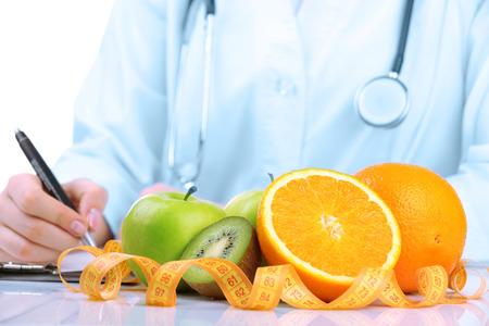 Nutritionist doctor writing  diet plan, closeup