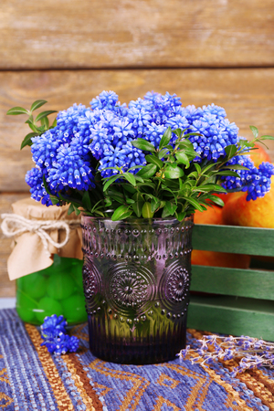 Blue bell flowers and flowers on wooden background
