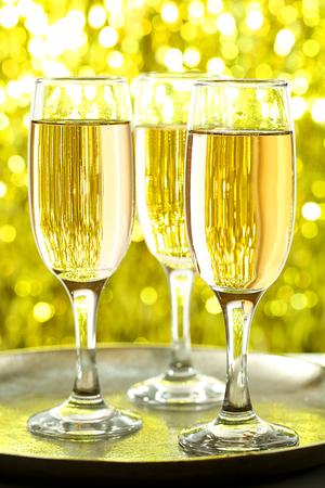 Glasses of champagne on bright background 版權商用圖片