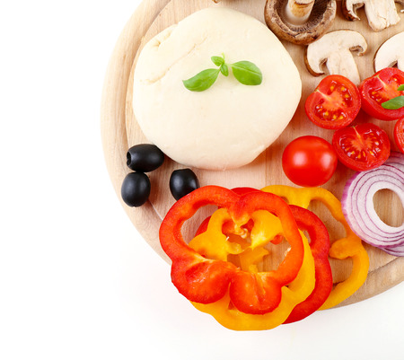 Food ingredients for pizza on cutting board isolated on white