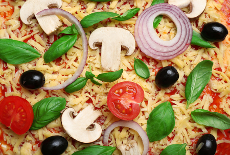 Raw pizza with vegetables close up Stock Photo