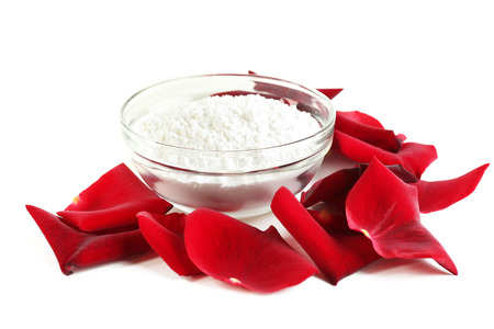 Fresh roses petals and bowl with sugar, isolated on white. Candied rose petals concept