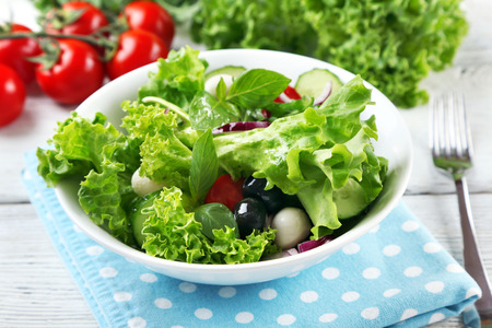 fresh vegetable salad in bowl on table close up Stock Photo