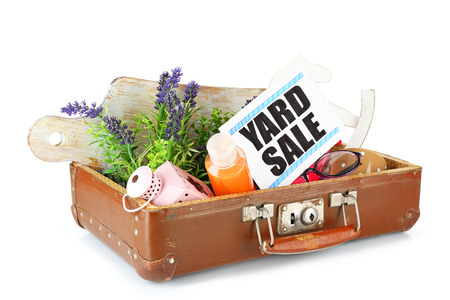 Old suitcase of unwanted stuff ready for yard sale isolated on white Stock Photo