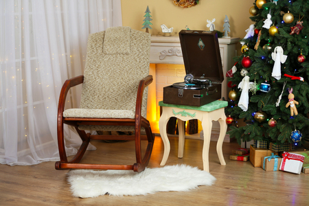 Beautiful Christmas interior with fireplace, turntable and fir tree Stock Photo