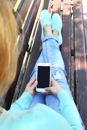Woman with mobile phone, outdoors Stock Photo