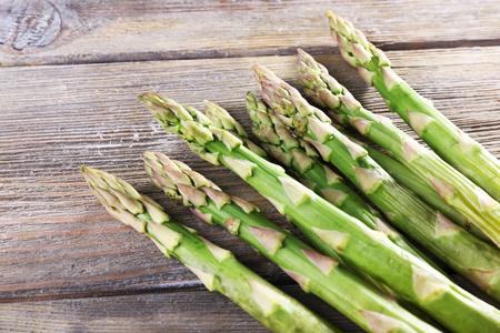 Fresh asparagus on wooden table, closeup Stock fotó