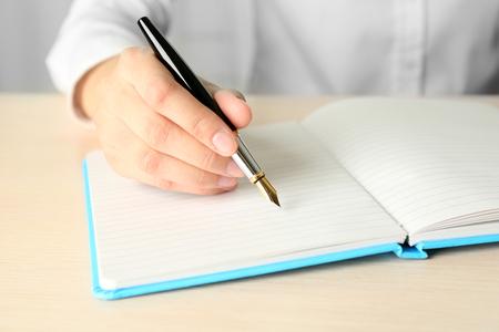 Businesswoman writing on document