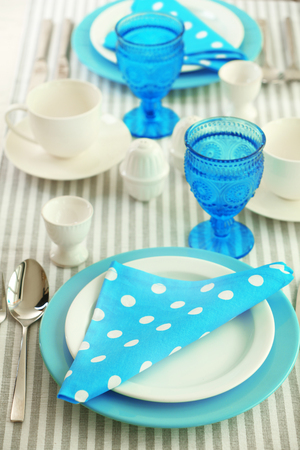 Beautiful holiday table setting in white and blue color 版權商用圖片