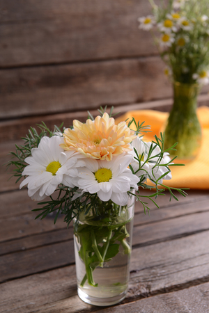 Beautiful flowers in vases on table close up Stock Photo