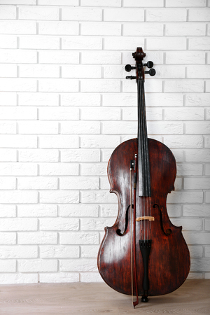 Cello on bricks wall background