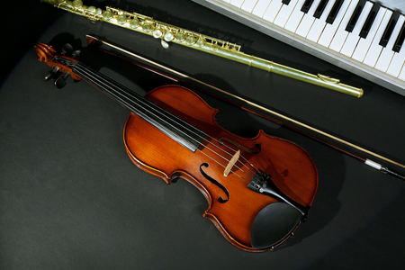 Musical instruments on dark background Stock Photo