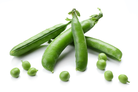 Fresh green peas isolated on white