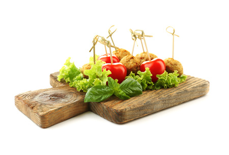 Meat balls on wooden cutting board isolated on white Stock Photo
