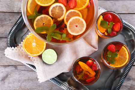 Fruity punch in glassware on metal tray, top view