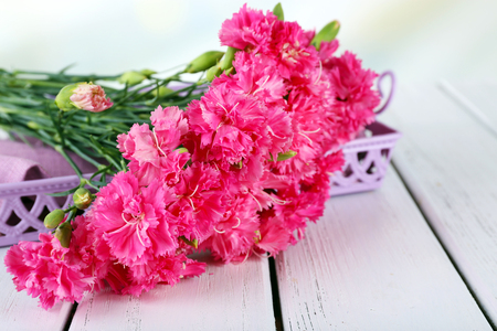 Beautiful bouquet of pink carnation on wooden table close up Stock Photo