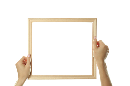 Female hands with wooden frame, isolated on white Banque d'images - 101757015