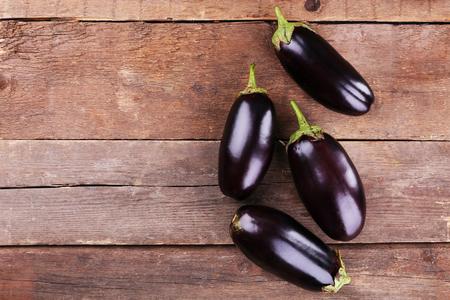 Fresh eggplant on wooden background