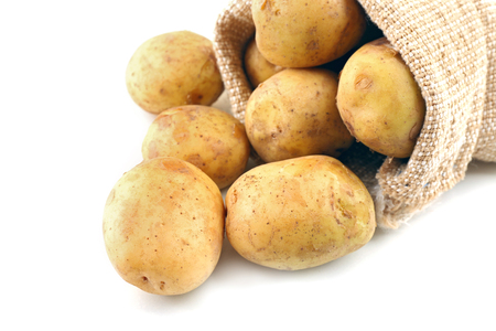 Young potatoes in sackcloth bag isolated on white Stock Photo