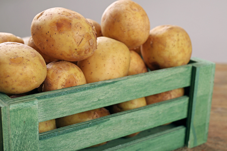 Young potatoes in crate close up Stock Photo