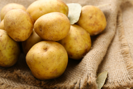 Young potatoes on sackcloth close up Stock Photo