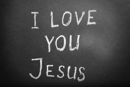 I LOVE YOU JESUS illustrated with chalk on black paper background