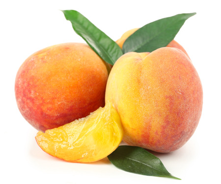 Ripe peaches isolated on white