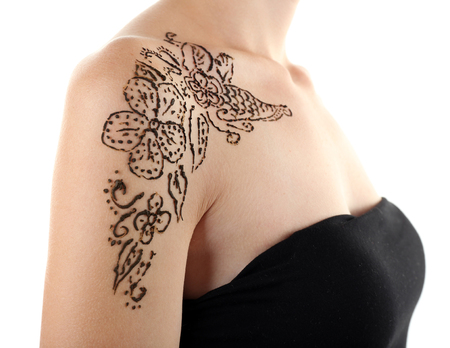 Shoulder painted with henna- Mehendi, isolated on white 免版税图像