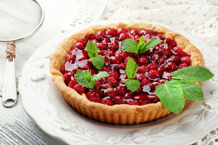 Tart with raspberries, on wooden background Stock Photo