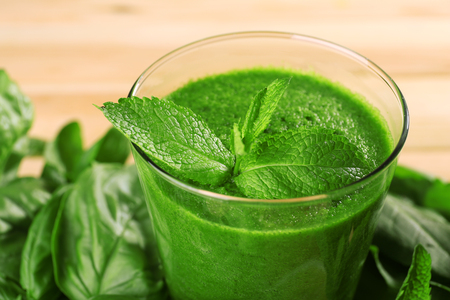 Green healthy juice with herbs close up