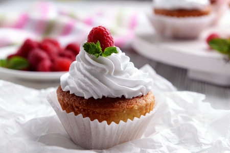 Delicious cupcake with berries on table close up
