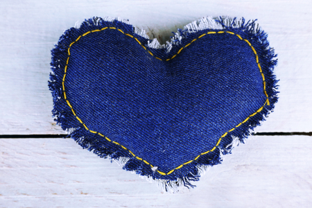 Denim heart on wooden background