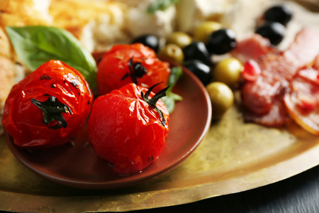 Ingredients of Mediterranean cuisine, on wooden tray, on wooden background