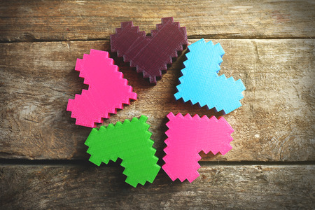 Plastic hearts on wooden background Banco de Imagens