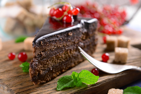 Tasty chocolate cake with berries on table close up